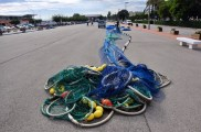 Fishing nets drying out in a parking lot.