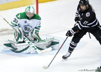 Grand Forks, ND; March 10, 2018; The #4 University of North Dakota men's hockey team opened the 2018 NCHC playoffs by hosting #5 Omaha at Ralph Engelstad Arena. UND won 4-3 in OT and move on to the Frozen Faceoff in St. Paul, MN. Photo by Russell Hons