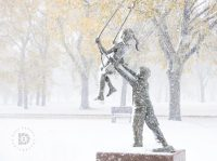 """Swinging in the Snowstorm"": I went out in the heavy snowstorm to take some early snow photos. Walking by this statue I stopped to capture this image."