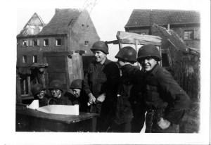 Latrine duty. Dick Skene, far left, Bob Dreier third from right.
