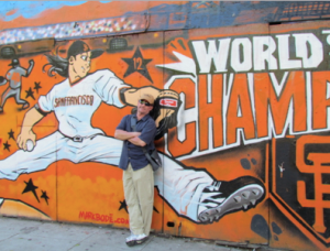 The author with Cartoon Tim Lincecum, once so popular San Francisco street artists honored the wiry, long-haired Cy Young winner with the marijuana arrest record.