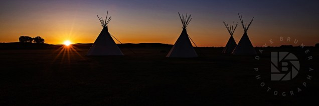 A beautiful early sunrise just peaking over the hills on this composition of Teepees created a look of what it must have looked like on the Great Plains of the Old Frontier of the past. I liked the balance of this image with the four main Teepees and with the rising sun to the left along with the different shades of color in the sky. The golden light reflection off the sides of the Teepees added to this early morning scene.
