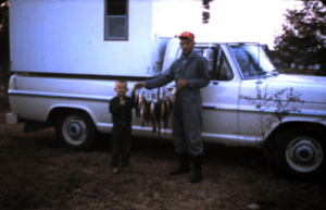 Dad with his youngest son, Thomas, on a trip they took to Mississippi. (The rest of us were in school.)
