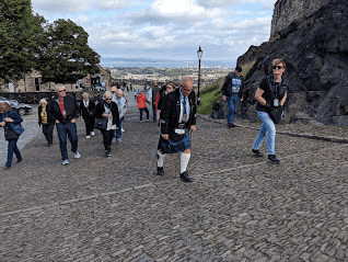 Tour of Edinburgh Castle by a local guide in traditional Scottish dress, including a brief look at the Scottish Crown Jewels and the birthroom of King James (he of the King James Bible) who became the first king of the United Kingdom, joining Scotland to England after the death of Elizabeth I, the Virgin Queen.