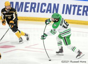 March 26, 2021 The American International Yellow Jackets take on the University of North Dakota Fighting Hawks in the second semi-final of the NCAA Men's Hockey Mid-West Regional at Scheels Arena, Fargo, ND. North Dakota won 5-1. Photo by Russell Hons/CSM