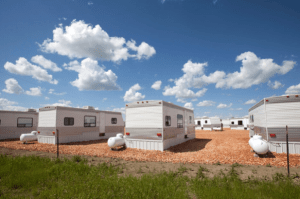 """An acute shortage of housing for out-of-state workers resulted in a profusion of so-called """"man camps"""" near drilling sites."""