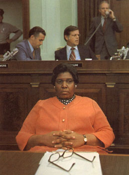 Barbara Jordan, in a pensive moment, in a House Committee room
