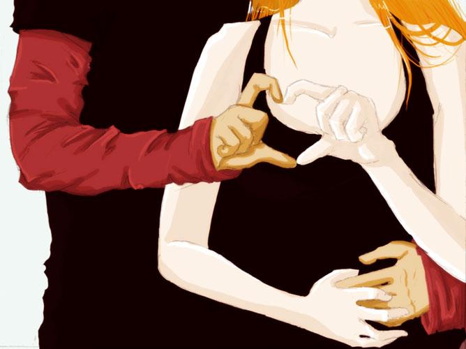 Férfi és nő szivecskét hoz létre az kezeikkel.