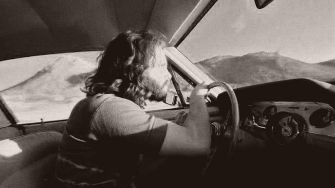 Jim Morrison driving.