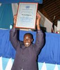 """United Nations Award  overal award winning Mirtin King'asia of Kenya Broadcasting coorporation show his UN  award, during  the Un day cerebrations at Kenyatta International Conference centre on October 23 2010. This year's theme is """"Working together for better Kenya"""" PHOTO/TOM MARUKO"""