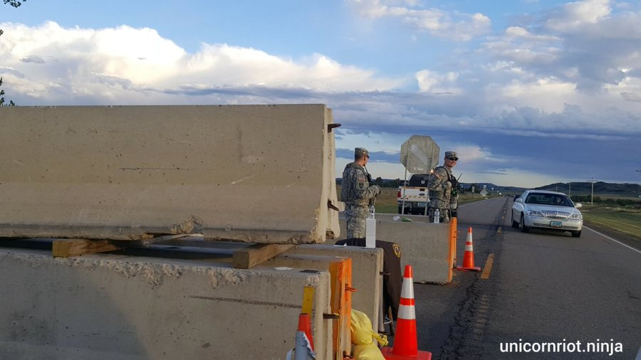 At Thursday's press conference, leaders assured the press that these concrete barriers will remain on Highway 1806 near the Missouri River, and the National Guard personnel will be armed.