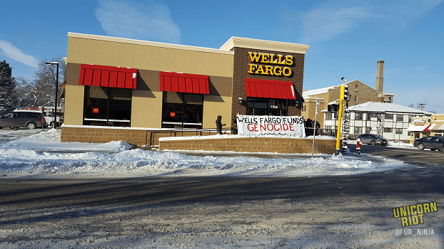 #DivestFromDAPL Action Disrupts Wells Fargo Branch Grand Opening, Doors Secured with Bike Locks