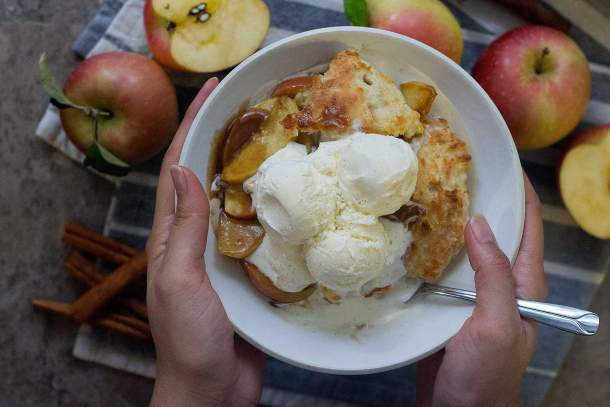 Serve homemade apple cobbler with vanilla ice cream.