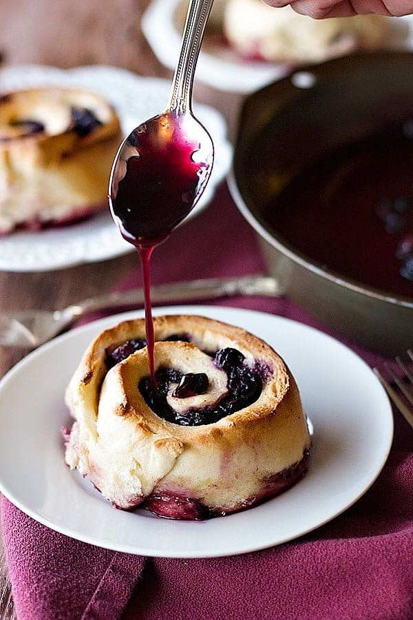 Blueberry Rolls are perfect for breakfast or dessert. Soft dough hugging around sweet and tangy blueberries, baked to perfection and smothered in the blueberry juice!