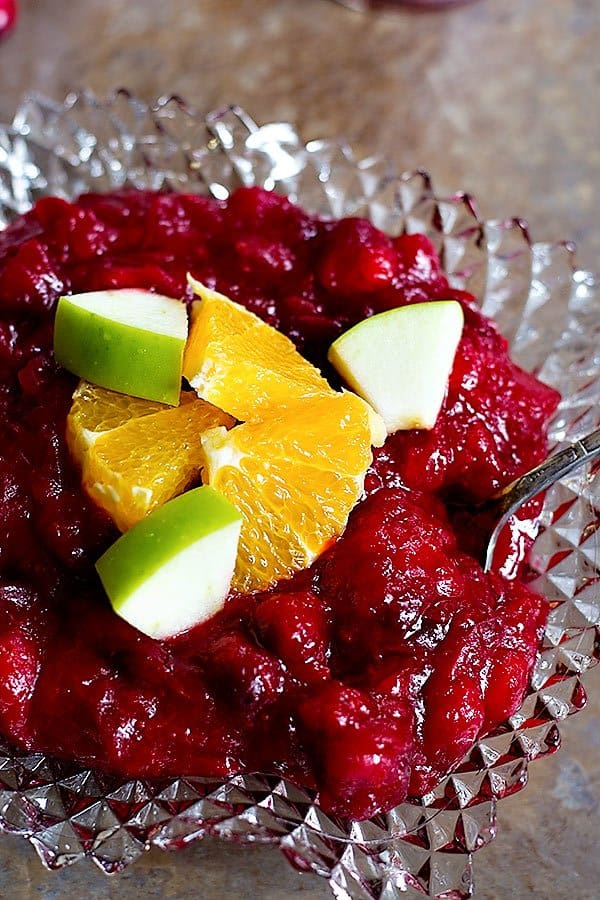Forget about store-bought cranberry sauce. This homemade apple cranberry sauce will be a new family tradition for you! This cranberry sauce with apples is tangy, sweet, and unbelievably easy!