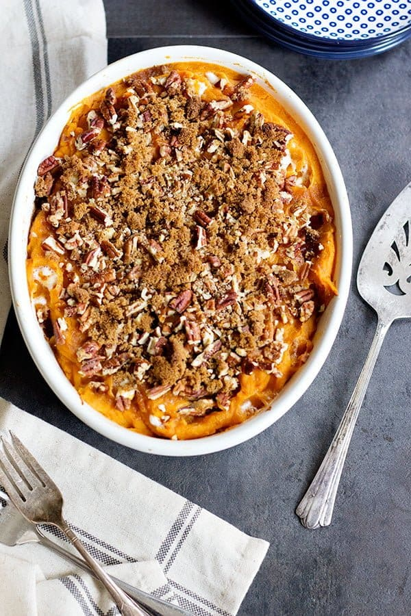 This classic Sweet Potato Casserole is a must-have for Thanksgiving. It's easy, fluffy and perfectly sweet. And, pecans add just the right amount of crunch!