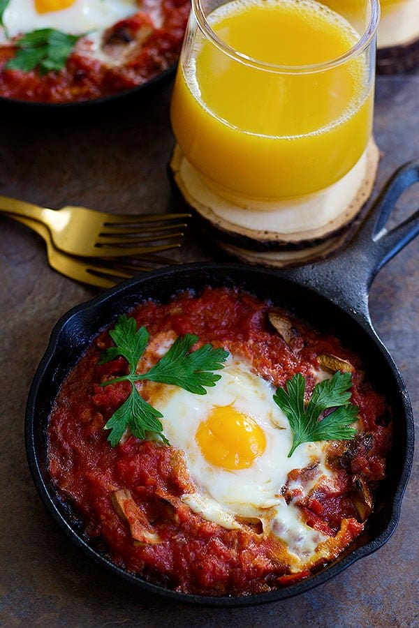 Baked Eggs with Sausage and Mushroom is a perfect breakfast dish for any day of the year. Fresh mushrooms and delicious sausage mixed with an amazing tomato sauce baked in the oven with eggs, can't get any better!