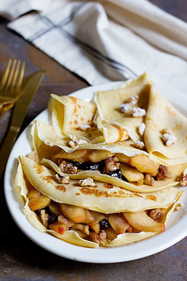 These Apple Pie Crepes are the perfect start to a beautiful day. You will love these light and lacy crepes filled with delicious apples and crispy walnuts!