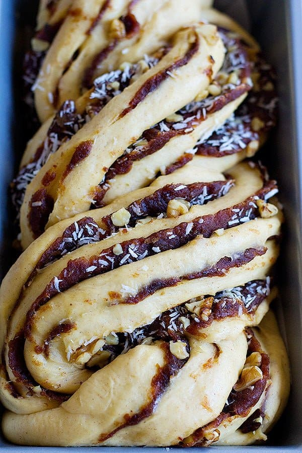 Unbaked date walnut babka made with dates and walnuts and coconuts.