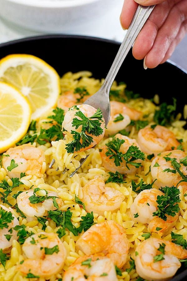 Start spring with this light and delicious Lemon Ginger Shrimp Orzo. It's full of fresh flavors and you can make it with just a few ingredients in only 25 minutes!