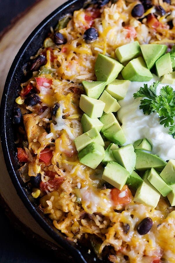Spice up your Taco Tuesdays with this delicious One Pan Cheesy Chicken Taco Rice. Everything you love about a good taco is in this skillet!