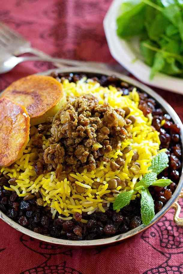 Adas Polo - Persian Lentil Rice is perfect for a weeknight meal. Rice and lentils served with delicious beef and raisins make the perfect healthy meal!