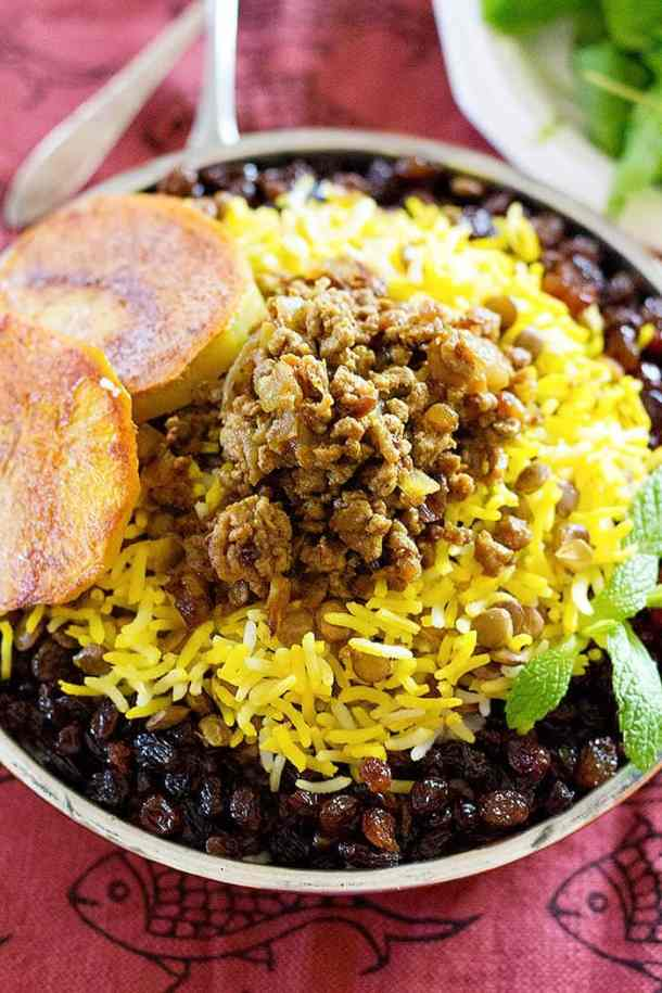 lentils and rice recipe is served with ground beef. raisins and saffron rice.