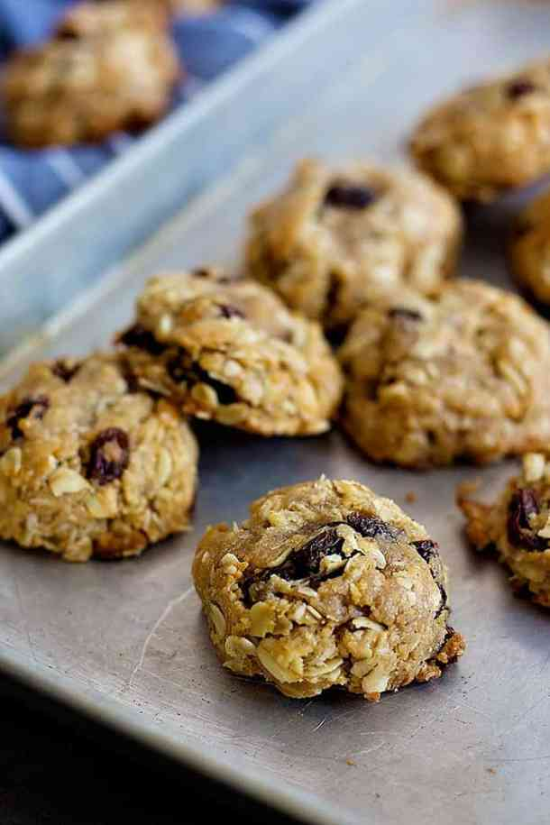 A match made in heaven, these Peanut Butter Oatmeal Raisin Cookies are perfect with a glass of milk! They are chewy, plump and very tasty!