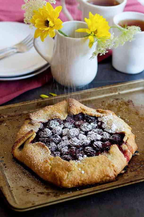 Sour cherry galette is one of my favorite summer treats! Galettes are free form tarts that can be filled with any fruits that are in season!