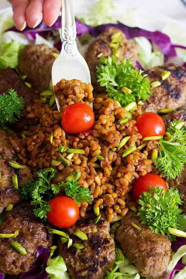 Spice up your usual meals with this Pomegranate Pistachio Koftas with Bulgur. Grilled koftas served with a delicious bulgur make the perfect meal!