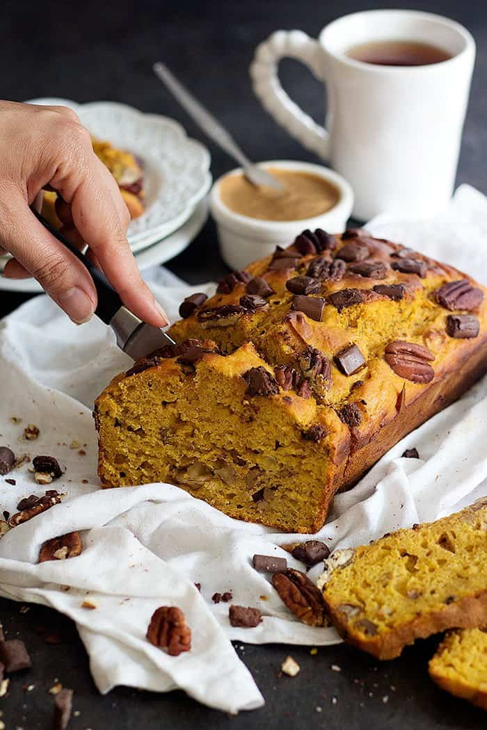 Healthy Pumpkin Banana Bread is made with Greek yogurt and is so soft. With chocolate chunks and pecans, this bread is completely irresistible!