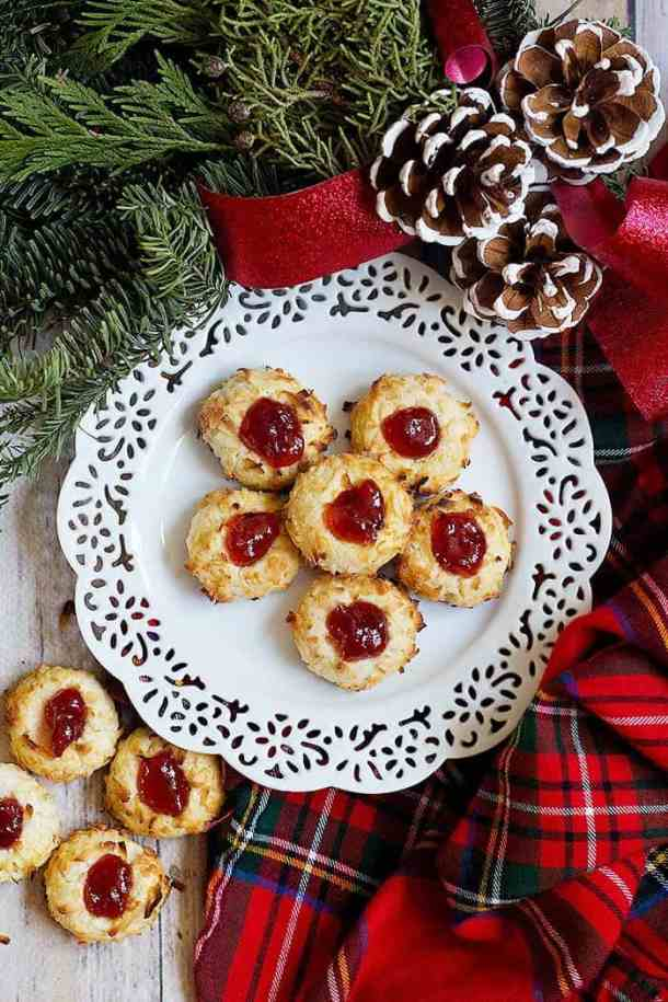 Coconut Thumbprint Cookies are a classic holiday favorite. These delicate cookies are baked to perfection and filled with delicious raspberry jam.