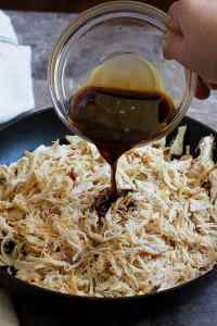 Pour the Asian sauce on shredded chicken and mix well. Cook until the chicken absorbs all the flavors.