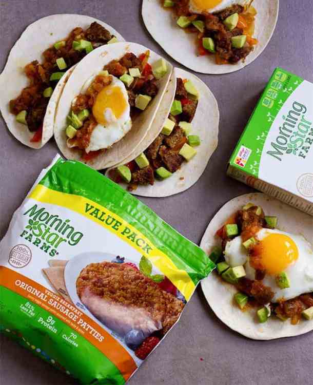 This Breakfast Tacos Recipe is an easy one that's perfect for any day of the week. Colorful veggies with avocado, salsa and a sunny side up egg make the best breakfast that everyone loves.