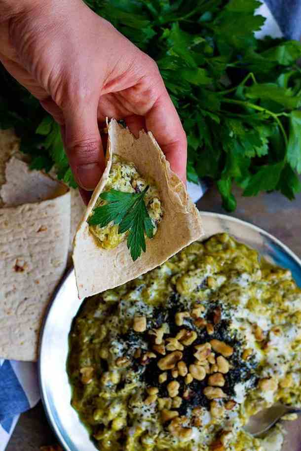 Serve kashke bademjoon with lavash bread and parsley or any other herbs.