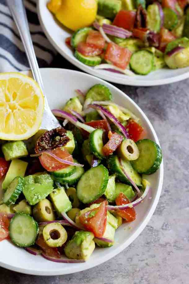 This cucumber tomato avocado summer salad is perfect for any day of the week. This easy and tasty salad comes together in no time and is full of flavor