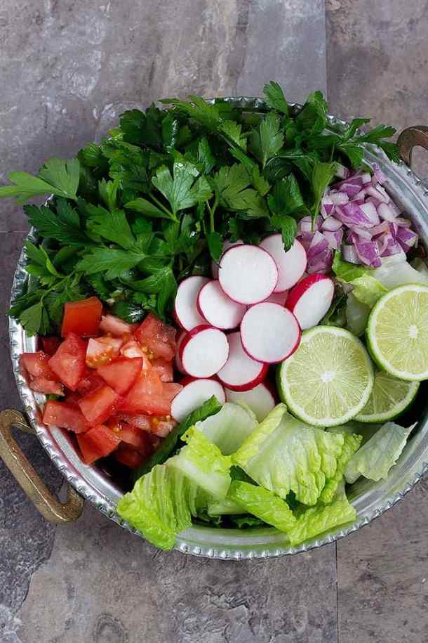 For fattoush recipe chop all the ingredients and mix them in a bowl.