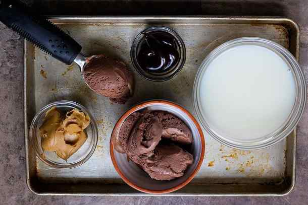 chocolate milkshake ingredients are chocolate ice cream, hot fudge sauce, milk and peanut butter