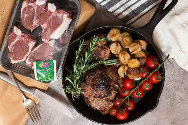 lamb loin chops seared in a skillet make a tasty dinner.