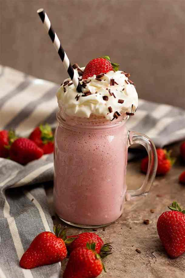 Strawberry milkshake made with fresh strawberries is the absolutely perfect drink! Learn how to make strawberry milkshakes that taste amazing.