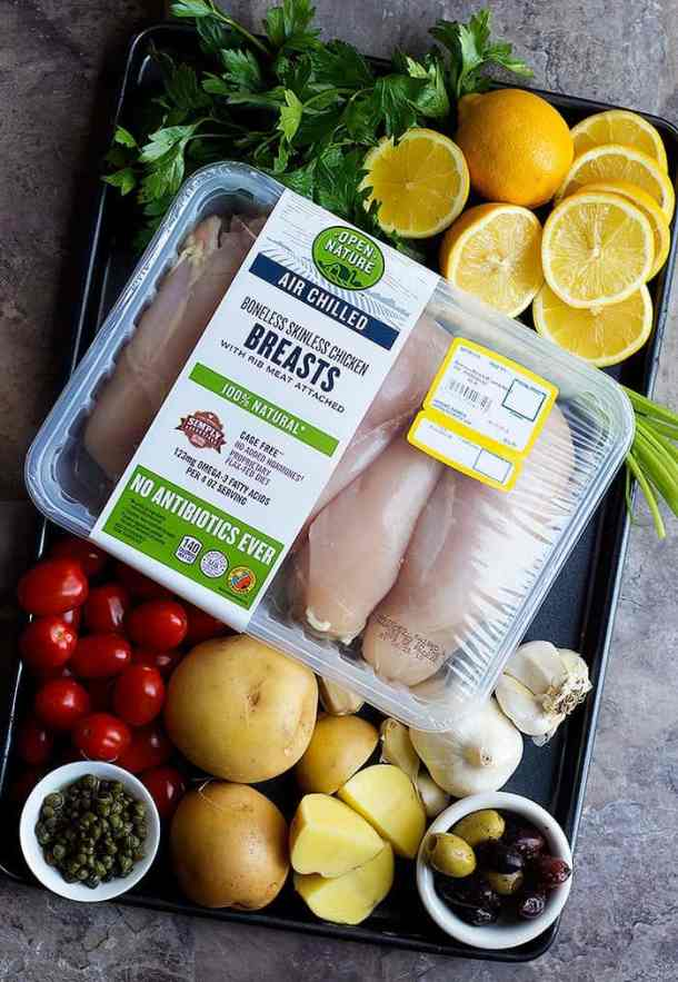 To make this Mediterranean chicken breast recipe you need chicken breast, potatoes, tomatoes, lemon, parsley, garlic, olives and capers.