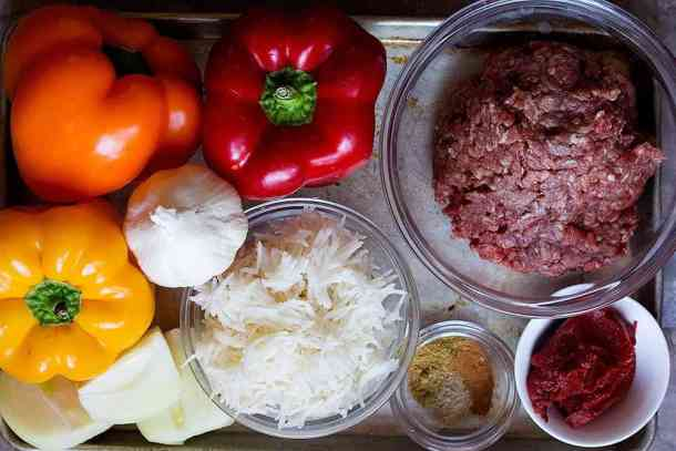 To make stuffed peppers in oven you need bell peppers, ground beef, onion, garlic, rice, tomato paste and spices.