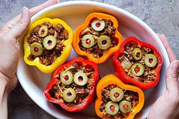 To make greek stuffed peppers, fill the bell peppers with the filling and bake in the oven.
