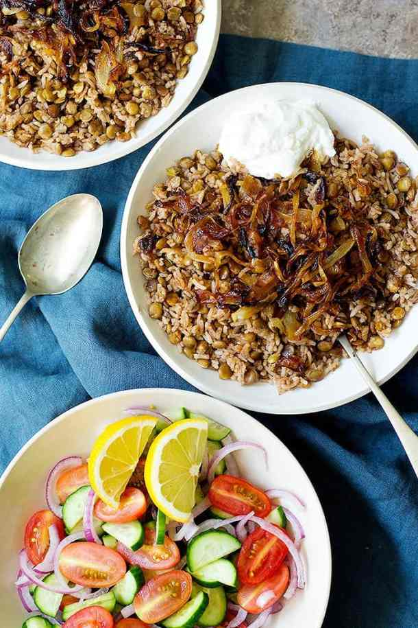 Mujadara is a simple lebanse lentil and rice dish with crispy onions that's packed with flavors. This Mujadara recipe calls for a few ingredients and is very easy to make.