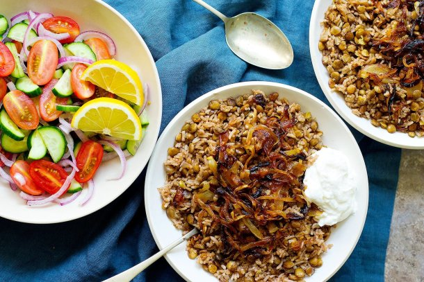 This lentil and rice recipe called mujadara is topped with caramelized onion and served with plain yogurt and salad.