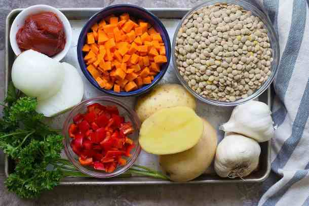 The ingredients to make this green lentil soup are lentils, carrots, onions, potatoes, garlic and spices.