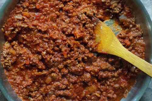 Greek moussaka - Add tomato paste and crushed tomatoes.