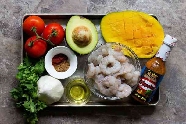 For spicy shrimp tacos you need shrimps, hot sauce, mango, olive oil, spices, garlic and avocado