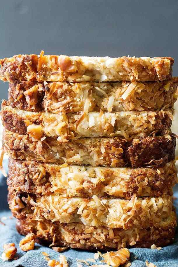 Slices of coconut banana bread stacked on top of each other.