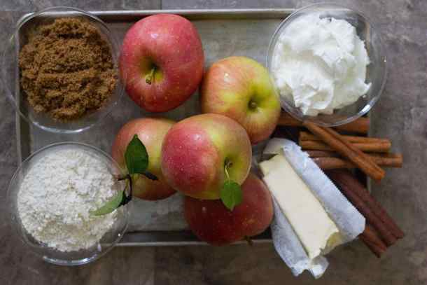 homemade apple cobbler ingredients are apples, brown sugar, yogurt, butter and flour.
